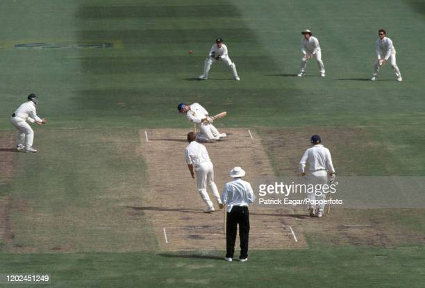 England batsman Graham Thorpe ducks a bouncer from Craig McDermott of Australia during the 2nd Test match between Australia and England at the MCG,...