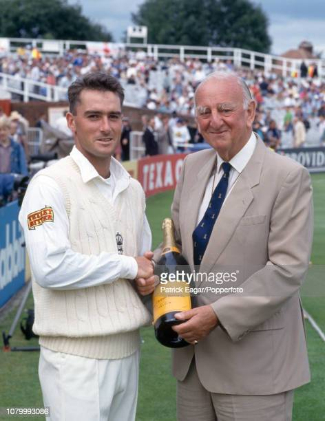 England batsman Graham Thorpe is presented with a bottle of champagne by BBC Test Match Special commentator Brian Johnston during the 4th Test match...