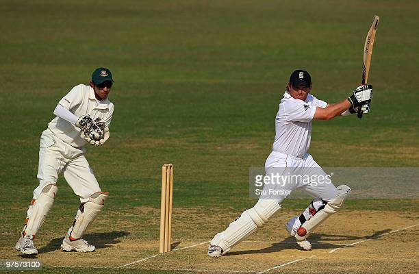 England batsman Ian Bell cuts a ball to the boundary watched by Bangladesh wicketkeeper Saghir Hossain during day three of the tour match between...