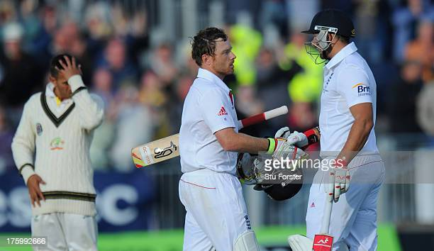 England batsman Ian Bell is congratulated by Tim Bresnan after reaching his century during day three of 4th Investec Ashes Test match between England...