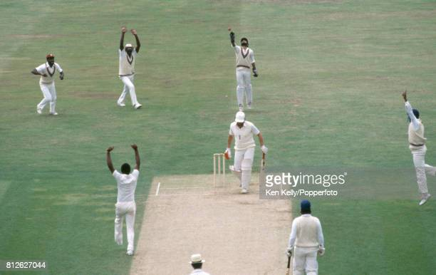 England batsman Ian Botham is caught behind for 14 runs by West Indies wicketkeeper Jeffrey Dujon off the bowling of Malcolm Marshall during the 5th...