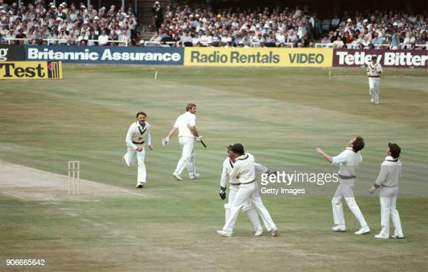 England batsman Ian Botham leaves the field after being dismissed in the 1st Innings caught behind by Rodney Marsh off the bowling of Dennis Lillee...