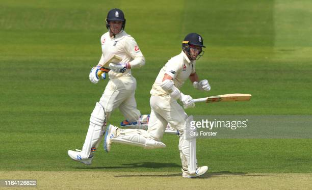 England batsman Jack Leach and Jason Roy pick up some runs during day two of the Specsavers Test Match between England and Ireland at Lord's Cricket...