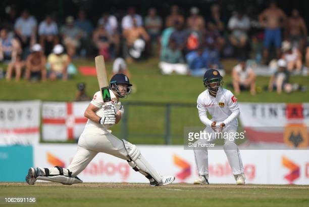 England batsman James Anderson sweeps to the boundary during Day Four of the Second Test match between Sri Lanka and England at Pallekele Cricket...