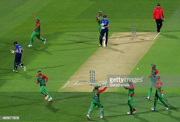 England batsman James Taylor walks back to the pavilion as Bangladesh celebrate his dismissal during their 2015 Cricket World Cup Pool A match at the...