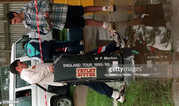 England batsman Jason Gallian helps carry the kit belonging to physiotherapist Wayne Morton over the puddles at the Jan Smuts Stadium,...