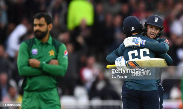 England batsman Jason Roy reaches his century and is congratulated by Joe Root as Hafeez reacts during the 4TH One Day International between England...