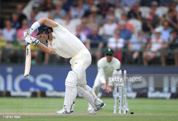 England batsman Joe Denly drives a ball to the boundary during Day Three of the Second Test between South Africa and England at Newlands on January...