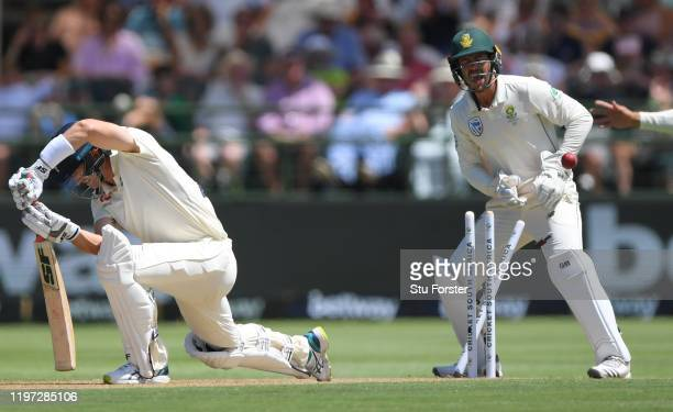 England batsman Joe Denly is bowled by South Africa bowler Keshav Maharaj as Quinto de Kock celebrates during Day One of the Second Test between...