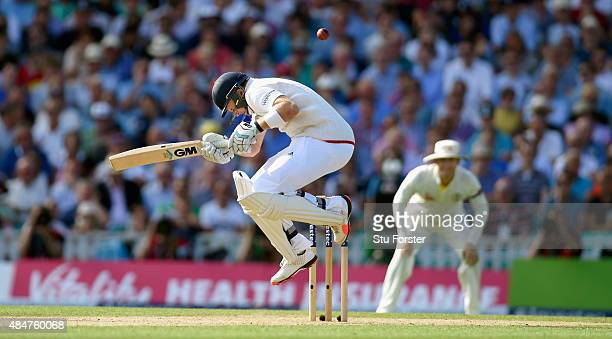 England batsman Joe Root avoids a short ball from Mitchell Johnson during day two of the 5th Investec Ashes Test match between England and Australia...