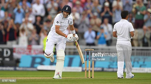 England batsman Joe Root celebrates his century as Pakistan bowler Yasif Shah looks on during day one of the 2nd Investec Test match between England...