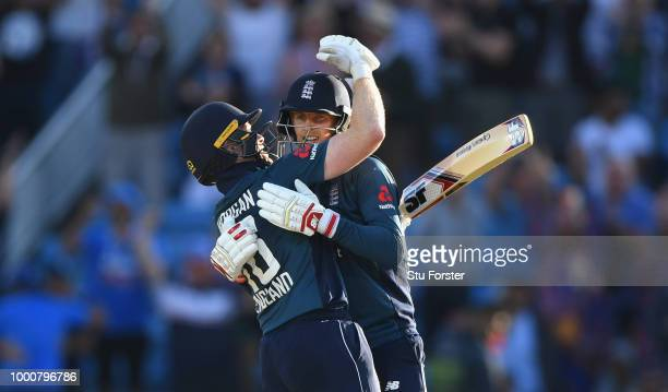 England batsman Joe Root celebrates his century off the last ball of the match with captain Eoin Morgan during 3rd ODI Royal London One Day match...