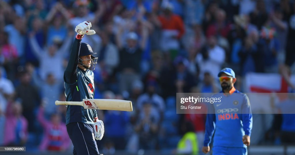 England batsman Joe Root celebrates his century off the last ball of the match as Virat Kohli looks on during 3rd ODI Royal London One Day match between England and India at Headingley on July 17, 2018 in Leeds, England.