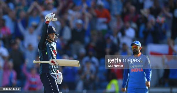 England batsman Joe Root celebrates his century off the last ball of the match as Virat Kohli looks on during 3rd ODI Royal London One Day match...