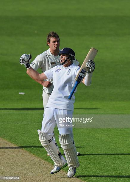 England batsman Joe Root celebrates his hundred as bowler Doug Bracewell looks on during day two of 2nd Investec Test match between England and New...