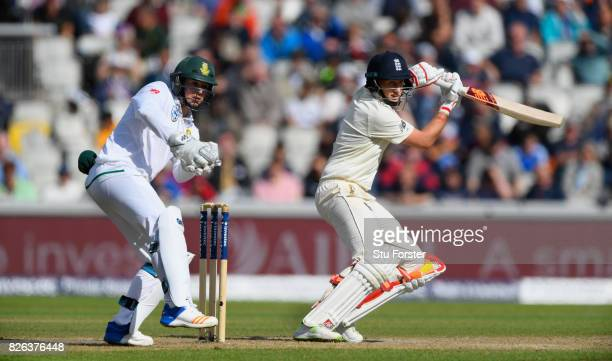 England batsman Joe Root cuts a ball to pick up some runs watched by Quinton de Kock during day one of the 4th Investec Test match between England...
