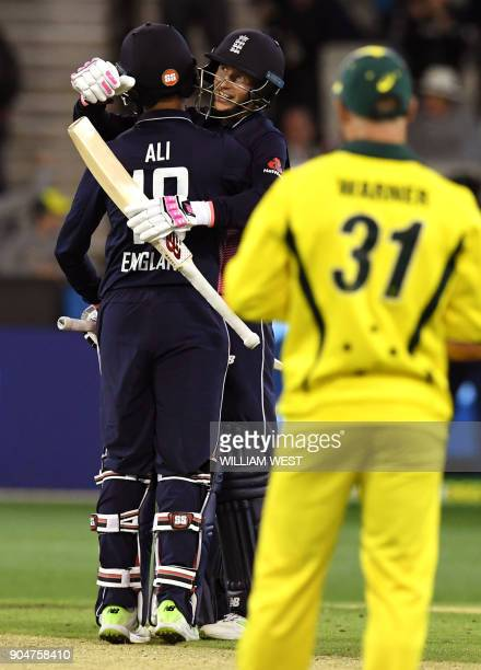 England batsman Joe Root embraces teammate Moeen Ali as Australia's David Warner looks on after England defeated Australia in their oneday...