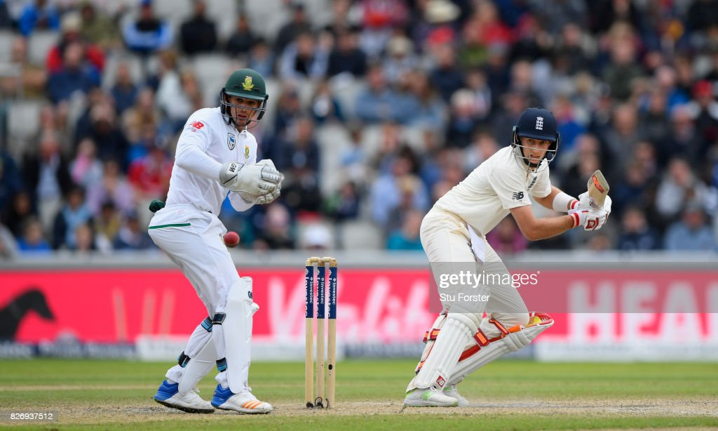 England batsman Joe Root fine cuts a ball towards the boundary watched by Quinton de Kock during day three of the 4th Investec Test Match between England and South Africa at Old Trafford on August 6, 2017 in Manchester, England.