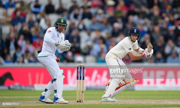 England batsman Joe Root fine cuts a ball towards the boundary watched by Quinton de Kock during day three of the 4th Investec Test Match between...