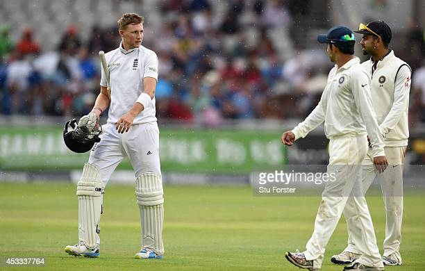 England batsman Joe Root has a chat with India fielder Virat Kohli as they leave the field due to rain during day two of the 4th Investec Test match...