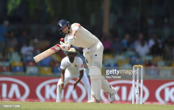 England batsman Joe Root hits out during Day One of the Third Test match between Sri Lanka and England at Sinhalese Sports Club on November 23, 2018...
