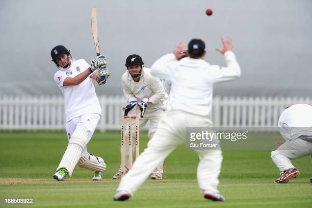 England batsman Joe Root hits out during day two of the tour match between England Lions and New Zealand at Grace Road on May 10 2013 in Leicester...