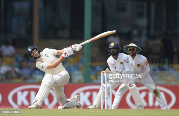 England batsman Joe Root hits out only to be caught out for 46 runs as watched by wicketkeeper Niroshan Dickwella during Day One of the Third Test...