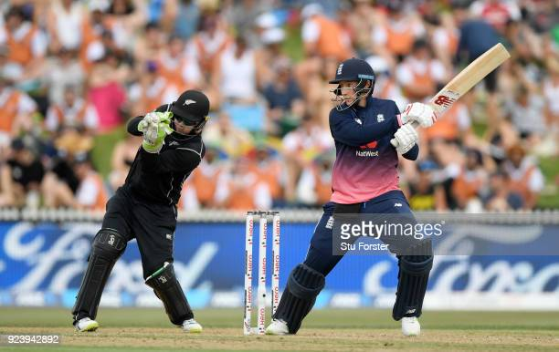 England batsman Joe Root hits out watched by Black Caps keeper Tom Latham during the 1st ODI between New Zealand and England at Seddon Park on...