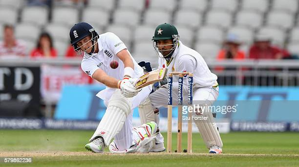 England batsman Joe Root hits out watched by Sarfraz Ahmed during day four of the 2nd Investec Test match between England and Pakistan at Old...