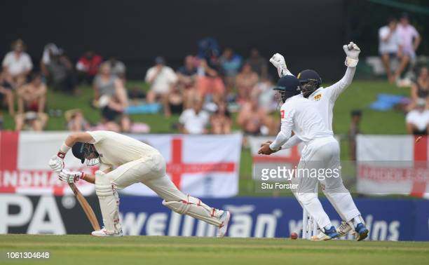 England batsman Joe Root is bowled by Pushpakumara and the Sri Lanka fielders celebrate during Day One of the Second Test match between Sri Lanka and...