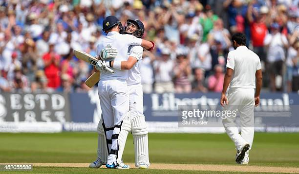 England batsman Joe Root is congratulated by James Aandersoon after Root had reached his century during day four of the 1st Investec Test Match...
