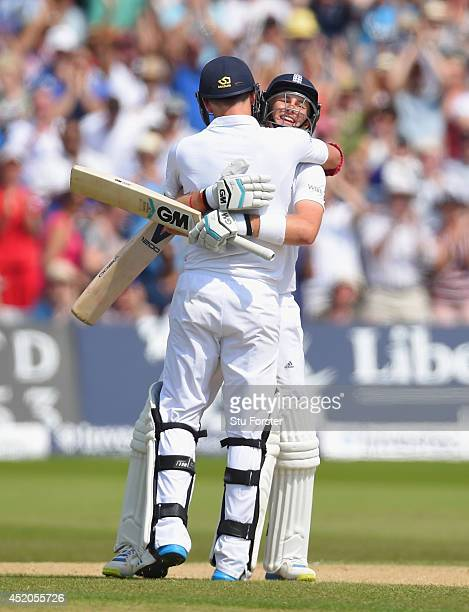 England batsman Joe Root is congratulated by James Anderson after Root had reached his century during day four of the 1st Investec Test Match between...