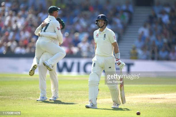 England batsman Joe Root leaves the field after being caught by David Warner off the bowling of Nathan Lyon during day four of the 3rd Ashes Test...