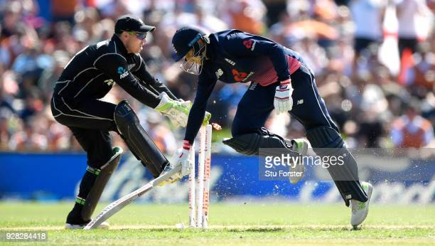 England batsman Joe Root makes his ground to reach his century desoite the run out attempt of Tom Latham during the 4th ODI between New Zealand and...