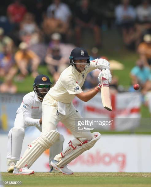 England batsman Joe Root picks up some runs during Day One of the Second Test match between Sri Lanka and England at Pallekele Cricket Stadium on...