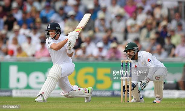 England batsman Joe Root prepares to reverse sweep to reach his double century watched by Sarfraz Ahmed during day two of the 2nd Investec Test match...