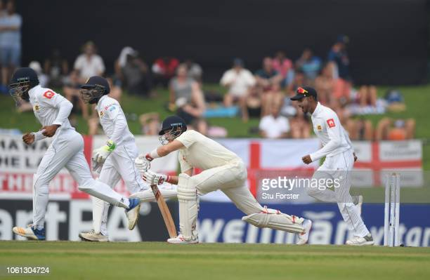 England batsman Joe Root reacts after being bowled by Pushpakumara and the Sri Lanka fielders celebrate during Day One of the Second Test match...
