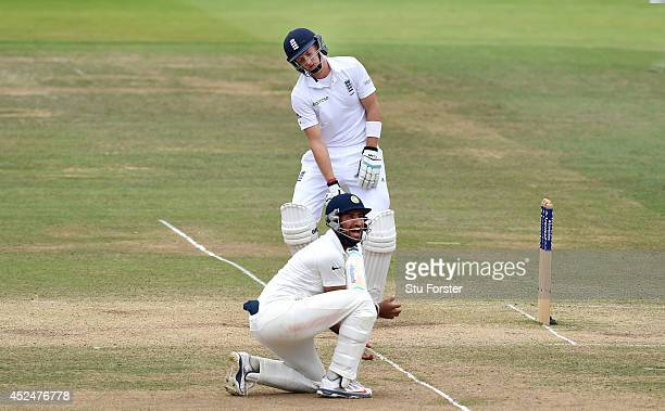 England batsman Joe Root reacts after being caught as Indian fielder Cheteshwar Pujara celebrates during day five of 2nd Investec Test match between...