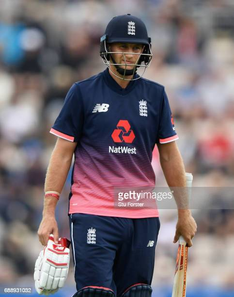 England batsman Joe Root reacts after South Africa bowler Dwaine Pretorius had run him out during the 2nd Royal London One Day International between...