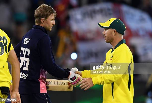 England batsman Joe Root shakes hands with Australia's David Warner after England defeated Australia in their oneday international cricket match...