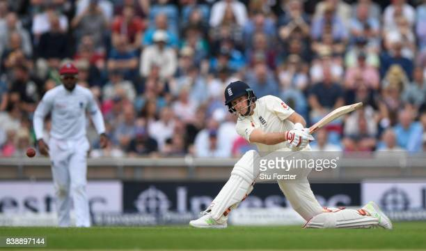 England batsman Joe Root sweeps a ball to the boundary to reach his 50 during day one of the 2nd Investec Test match between England and West Indies...