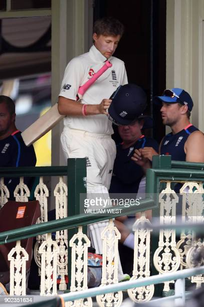 England batsman Joe Root walks out to bat after needing hospital treatment for severe dehydration on the final day of the fifth Ashes cricket Test...