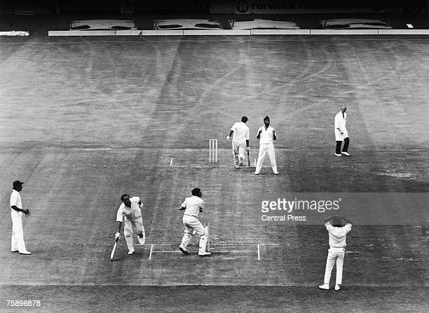 England batsman John Jameson is run out for 82 by Farokh Engineer of India during the Third Test at the Oval, London, August 1971. India won the test...