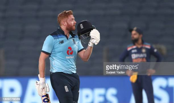 England batsman Jonathan Bairstow celebrates his century during the 2nd One Day International between India and England at MCA Stadium on March 26,...