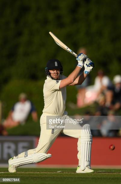 England batsman Jonathan Bairstow drives a ball to the boundary during day one of the Second Test Match between the New Zealand Black Caps and...