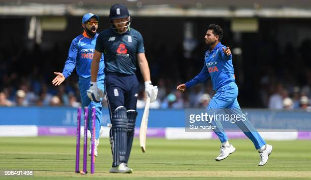 England batsman Jonathan Bairstow is bowled by India bowler Kuldeep Yadav as he celebrates with Virat Kohli during the 2nd ODI Royal London One Day...