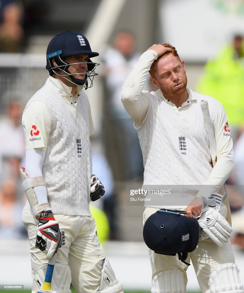 England batsman Jonathan Bairstow (r) reacts as James Anderson (l) and him await the 4th umpires decision before being given out for 99 runs after review during day two of the 4th Investec Test match between England and South Africa at Old Trafford on August 5, 2017 in Manchester, England.
