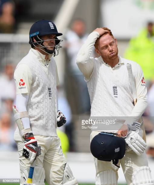 England batsman Jonathan Bairstow reacts as James Anderson and him await the 4th umpires decision before being given out for 99 runs after review...