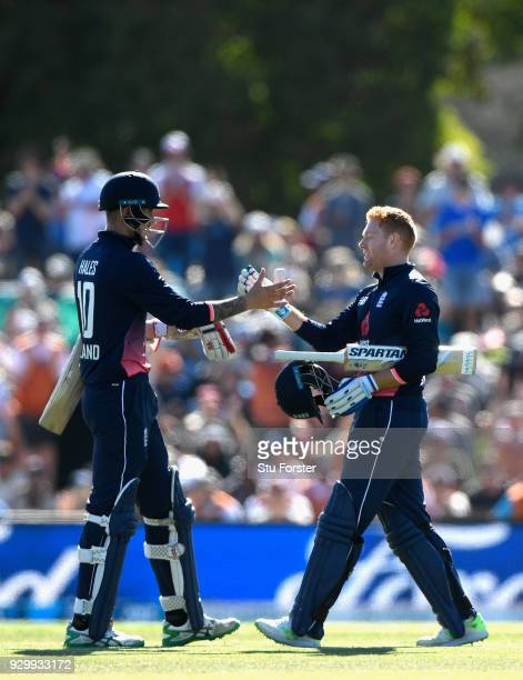 England batsman Jonny Bairstow celebrates his century with Alex Hales during the 5th ODI between New Zealand and England at Hagley Oval on March 10...