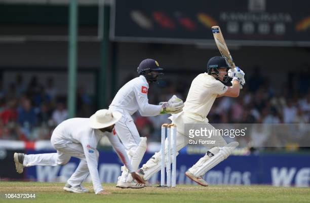 England batsman Jonny Bairstow cuts a ball to the boundary watched by Niroshan Dickwella during Day One of the Third Test match between Sri Lanka and...